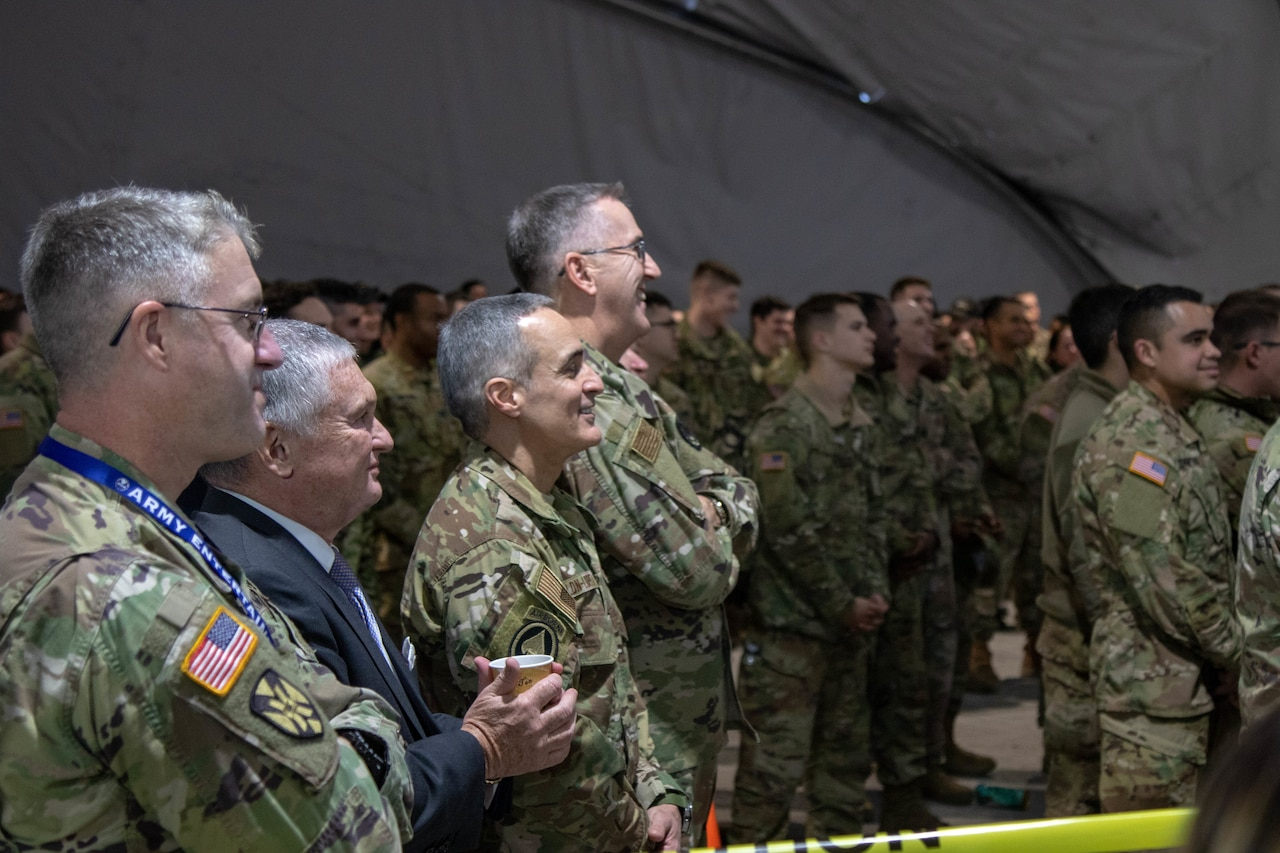 Service members watch a USO show.