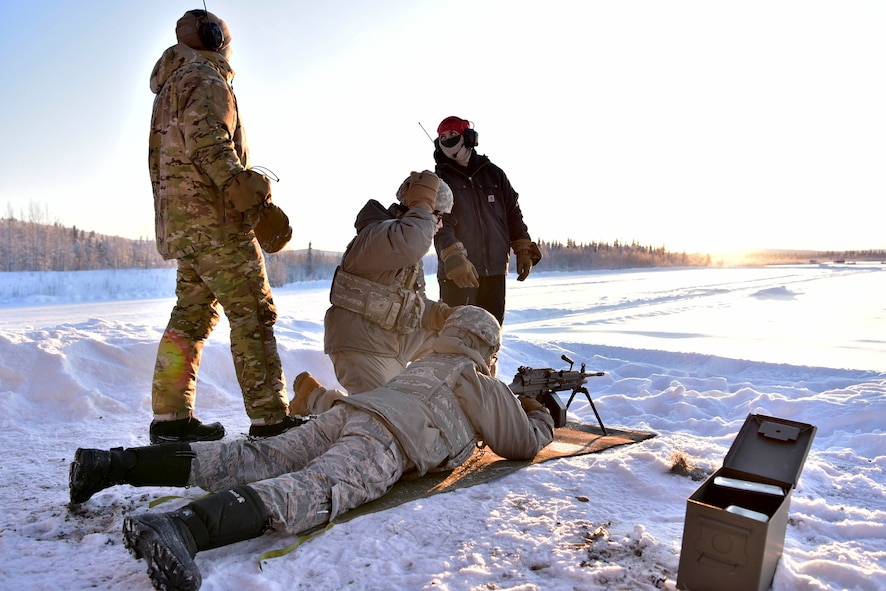 354th Security Forces Squadron Combat Arms Training and Maintenance instructors prepare Airmen to fire an M-249 Squad Automatic Weapon at Eielson Air Force Base, Alaska, Jan. 9, 2020. CATM instructors are responsible for training the 354th Fighter Wing how to use various small arms weapon systems. (U.S. Air Force photo by Senior Airman Beaux Hebert)