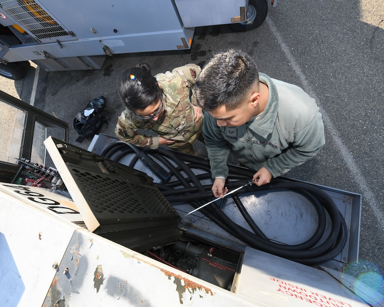 Senior Airman Miguel Fraire, 9th Maintenance Squadron aerospace ground equipment technician, and Senior Airman Sierra Garcia, 9th MXS AGE apprentice, inspect the oil on a generator, Jan. 7, 2020 at Beale Air Force Base California. These professionals play a big role on helping the 9th Reconnaissance Wing accomplish its mission by providing the needed equipment to requesting units. (U.S. Air Force photo by Airman 1st Class Luis A. Ruiz-Vazquez)