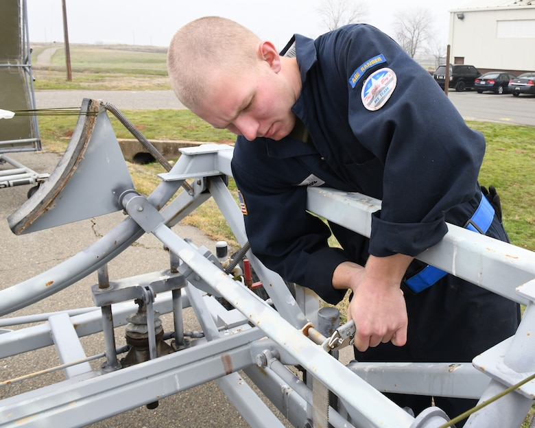 Airman 1st Class Calvin Wilkins, 9th Maintenance Squadron aerospace ground equipment journeyman, loosens a nut on an aircraft dolly to remove a strap, Jan. 7 2020 on Beale Air Force Base, California. AGE is a 24/7 operation that is divided into four sections; maintenance, inspection, service and delivery, and support. (U.S. Air Force photo by Airman 1st Class Luis A. Ruiz-Vazquez)