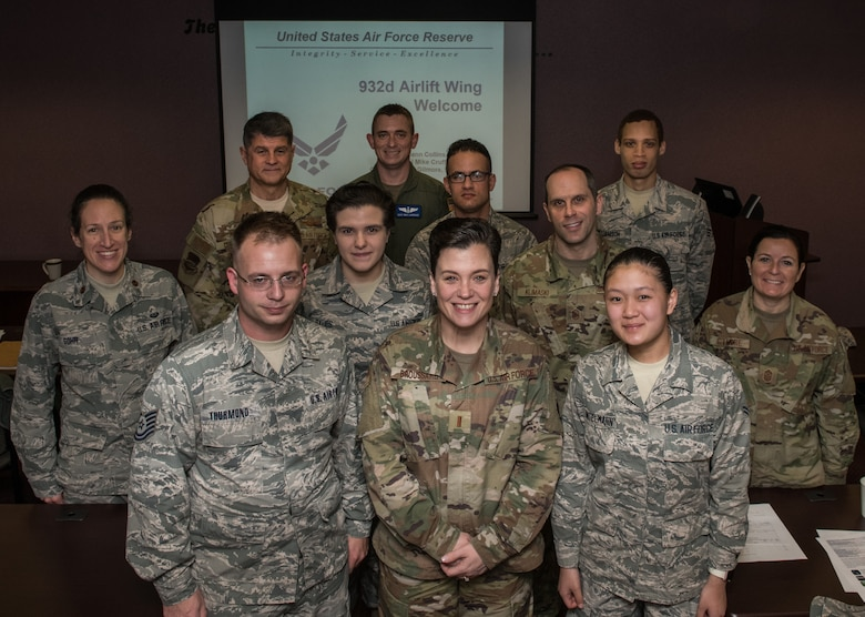 932nd Airlift Wing commander, Col. Glenn Collins, left, rear row, along with Command Chief Barbara Gilmore, far right, take a photo moment with the newest Citizen Airmen to join the 932nd AW family, Jan. 11, 2020, Scott Air Force Base, Illinois at the monthly newcomers briefing.  Each unit training assembly leadership greets, shares the 932nd AW mission, organization chart and answers questions as a welcome to the Wing.  (U.S. Air Force photo by Master Sgt. Christopher Parr)