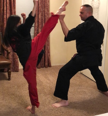 Senior Master Sgt. Scott Newberger, 161st Air Refueling Wing Human Resource Advisor and committee member on the Diversity and Inclusion Council, practices martial arts techniques with his daughter Jeanette, Gilbert Ariz., December, 2019. (Courtesy photo, SMSgt Scott Newberger)