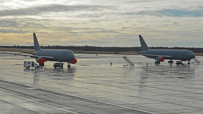 Two 157th Air Refueling Wing KC-46A Pegasus aerial refueling tankers juxtaposed on the tarmac at Pease Air National Guard Base, N.H., Jan. 12. The aircraft arrived on Jan. 10. The delivery brings Pease's inventory to four jets; eight more are slated for delivery before the end of the year. (U.S. Air National Guard photo by Staff Sgt. Curtis Lenz)