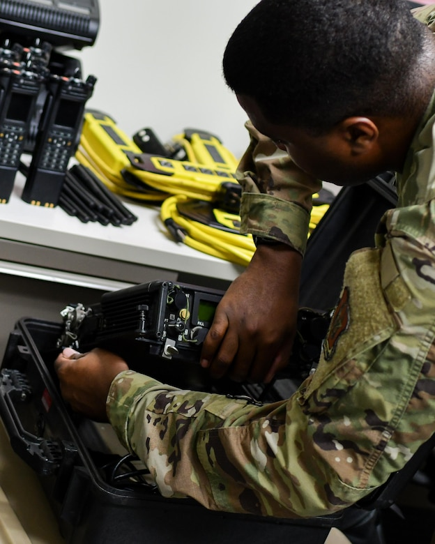 Staff Sgt. Malik Flowers, a radio frequency transmission systems technician assigned to the 910th Communications Squadron, packs radio equipment for an upcoming mission to Jacksonville Florida, Jan. 11, 2019, at Youngstown Air Reserve Station.