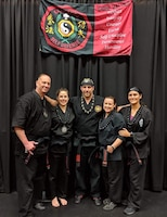 Senior Master Sgt. Scott Newberger, assigned to the 161st Air Refueling Wing, poses with fellow back belt Dojo martial artists, Phoenix, Ariz., December 17, 2019. Newberger is passionate about his experience in martial arts and how it propels him in his military career. (Courtesy photo, SMSgt Scott Newberger)