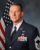 Air Force official photo of 178th Command Chief Scott Ross (gray background with flag)
