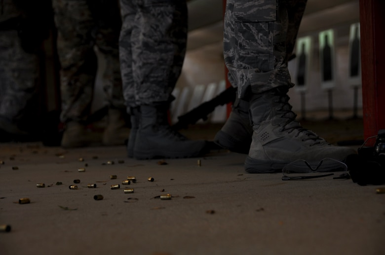 Empty 9 mm shell casings litter the floor around 908th Security Forces Squadron defenders, Nov. 2, 2019, in the firing bay at Maxwell AFB, Alabama. SFS Airmen have to annually requalify with the M9, M16 and other various weapon systems. (U.S. Air Force photo by Airman 1st Class Shelby S. Thurman)