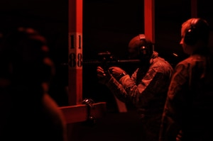 Technical Sgt. Marcus Johnson, 908th Security Forces Squadron defender, shoots his M4 carbine with night vision optics Nov. 2, 2019, in the firing bay at Maxwell AFB, Alabama. The SFS defenders train for multiple types of scenarios so that they are prepared to fight in any type of situation and anywhere at a moment's notice. (U.S. Air Force photo by Airman 1st Class Shelby S. Thurman)