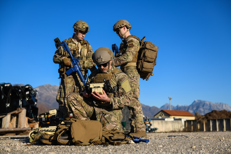 U.S. Air Force Staff Sgt. Jackson Judge, left, Airman 1st Class Tyler McConnell, and Senior Airman Colby Forsythe, explosive ordnance team members from the 31 Civil Engineer Squadron, prepare equipment during a training exercise at Aviano Air Base, Italy, Jan. 8, 2020. EOD Airmen are often assigned to some of the most dangerous missions and  perform tactically harrowing and technically demanding tasks in diverse environments worldwide. (U.S. Air Force photo by Airman 1st Class Ericka A. Woolever).