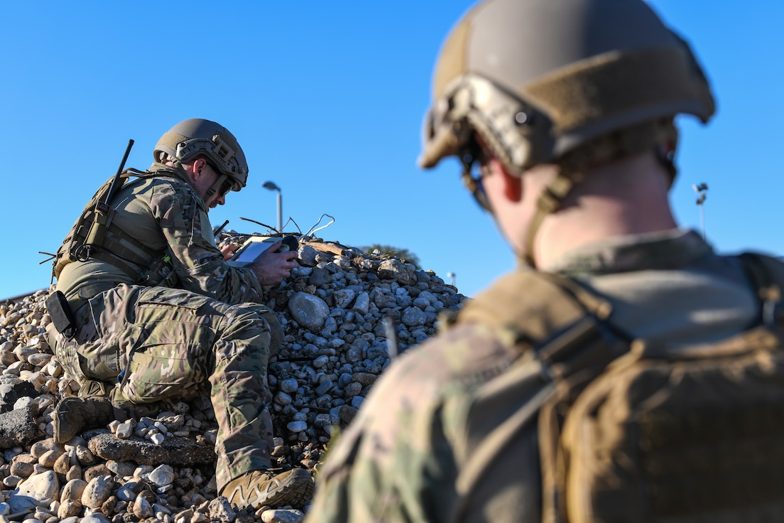 U.S. Air Force Airman 1st Class Tyler McConnell, left, and Senior Airman Colby Forsythe, explosive ordnance team members from the 31 Civil Engineer Squadron, attempt to reconnect the operation control unit to the Micro Tactical Ground Robot during a training exercise at Aviano Air Base, Italy, Jan. 8, 2020.  (U.S. Air Force photo by Airman 1st Class Ericka A. Woolever).