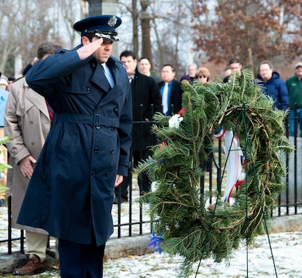 New York Air National Guard Lt. Col. Shawn Reynolds, deputy commander of the 107th Attack Wing's 107th operations group, presents a wreath from President Trump at the grave of Millard Fillmore, the 13th president of the United States, at Forest Lawn Cemetery in Buffalo, N.Y., Jan. 7, 2020, on the 220th anniversary of Fillmore's death.