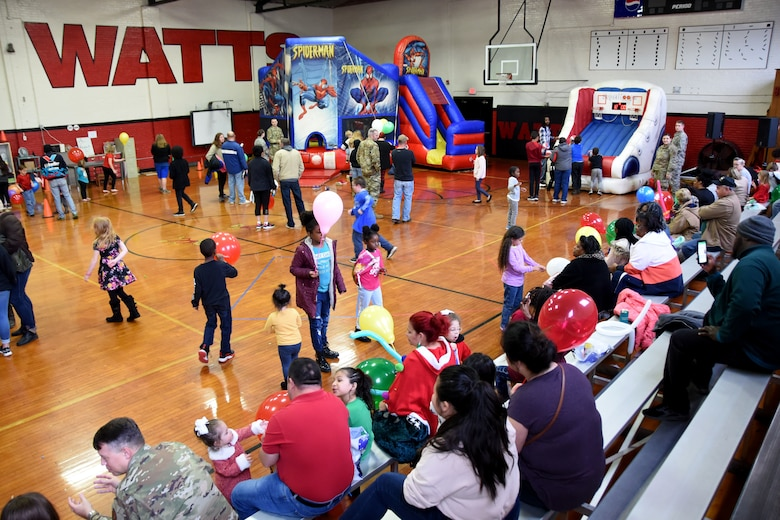 Students and families of Badin Elementary School (B.E.S.) mill around from craft tables to bouncy castles during Operation Santa held at B.E.S., Badin, N.C., Dec. 14th, 2019.  Operation Santa is an annual event run by the Chapter 7 organization of the North Carolina Air National Guard (NCANG) which chooses select schools to provide assistance to families during the holiday season. This year, the NCANG provided presents, lunch, music, bouncy castles and a Santa. The NCANG also partnered with the local Target for food donations.