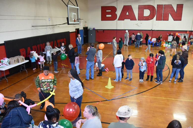 Students and families of Badin Elementary School (B.E.S.) wait in line to meet with a volunteer Santa during Operation Santa held at B.E.S., Badin, N.C., Dec. 14th, 2019.  Operation Santa is an annual event run by the Chapter 7 organization of the North Carolina Air National Guard (NCANG) which chooses select schools to provide assistance to families during the holiday season. This year, the NCANG provided presents, lunch, music, bouncy castles and a Santa. The NCANG also partnered with the local Target for food donations.