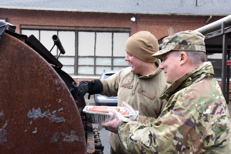 U.S. Air Force Senior Master Sgt. Carl Champagne (left), 263rd Flight Operations superintendent and Lt. Col. Bradley Claxton (right), 263rd Combat Communications commander, enjoy grilling nearly 400 hot dogs during Operation Santa held at Badin Elementary School, Badin, N.C., Dec. 14th, 2019.  Operation Santa is an annual event run by the Chapter 7 organization of the North Carolina Air National Guard (NCANG) which chooses select schools to provide assistance to families during the holiday season. This year, the NCANG provided presents, lunch, music, bouncy castles and a Santa. The NCANG also partnered with the local Target for food donations.