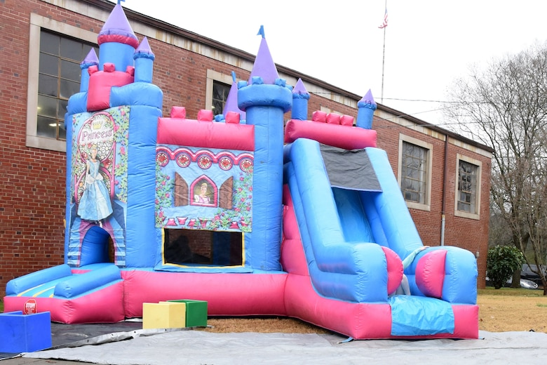 A princess bouncy castle is put to use at Badin Elementary School (B.E.S.) during Operation Santa held at B.E.S., Badin, N.C., Dec. 14th, 2019.  Operation Santa is an annual event run by the Chapter 7 organization of the North Carolina Air National Guard (NCANG) which chooses select schools to provide assistance to families during the holiday season. This year, the NCANG provided presents, lunch, music, bouncy castles and a Santa. The NCANG also partnered with the local Target for food donations.