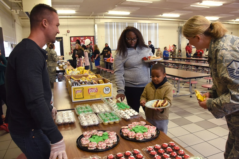 Volunteers from the North Carolina Air National Guard (NCANG) assist students with a hot lunch at Badin Elementary School (B.E.S.) during Operation Santa held at B.E.S., Badin, N.C., Dec. 14th, 2019.  Operation Santa is an annual event run by the Chapter 7 organization of the NCANG which chooses select schools to provide assistance to families during the holiday season. This year, the NCANG provided presents, lunch, music, bouncy castles and a Santa. The NCANG also partnered with the local Target for food donations.