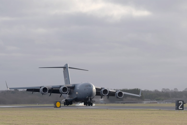 A C-17 Globemaster III assigned to the Heavy Airlift Wing, Pápa Air Base, Hungary, lands at RAF Mildenhall, England, Jan. 11, 2020. The HAW came to RAF Midenhall to deliver the Boom Operator Weapon System Trainer. (U.S. Air Force photo by Senior Airman Benjamin Cooper)