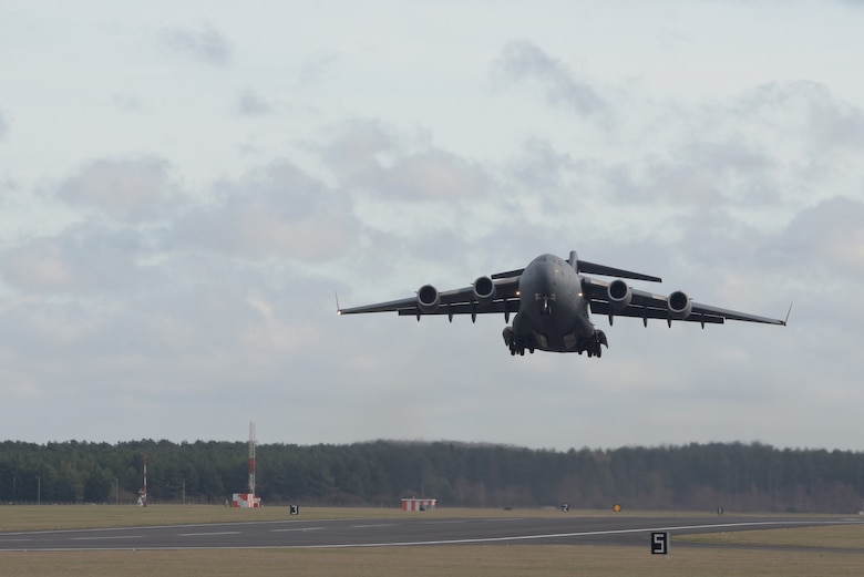 A C-17 Globemaster III assigned to the Heavy Airlift Wing, Pápa Air Base, Hungary, takes off after delivering the Boom Operator Weapon System Training System at RAF Mildenhall, England, Jan. 11, 2020. The BOWST is a simulator used by boom operators to provide hands-on training without leaving the ground. (U.S. Air Force photo by Senior Airman Benjamin Cooper)