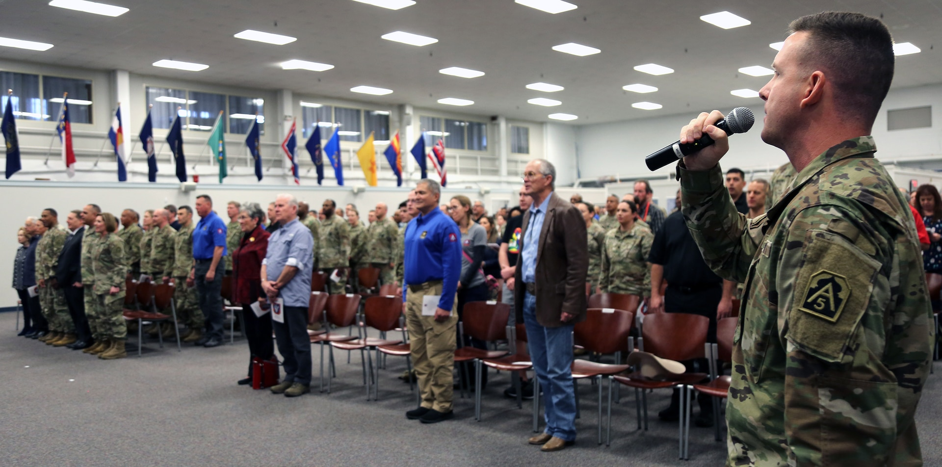"""First Sgt. Scott Boyle sings the National Anthem during the U.S. Army North (Fifth Army) 77th birthday celebration at the Military & Family Readiness Center at JBSA-Fort Sam Houston Jan. 10. Boyle is the first sergeant for the 323rd U.S. Army Band """"Fort Sam's Own."""""""