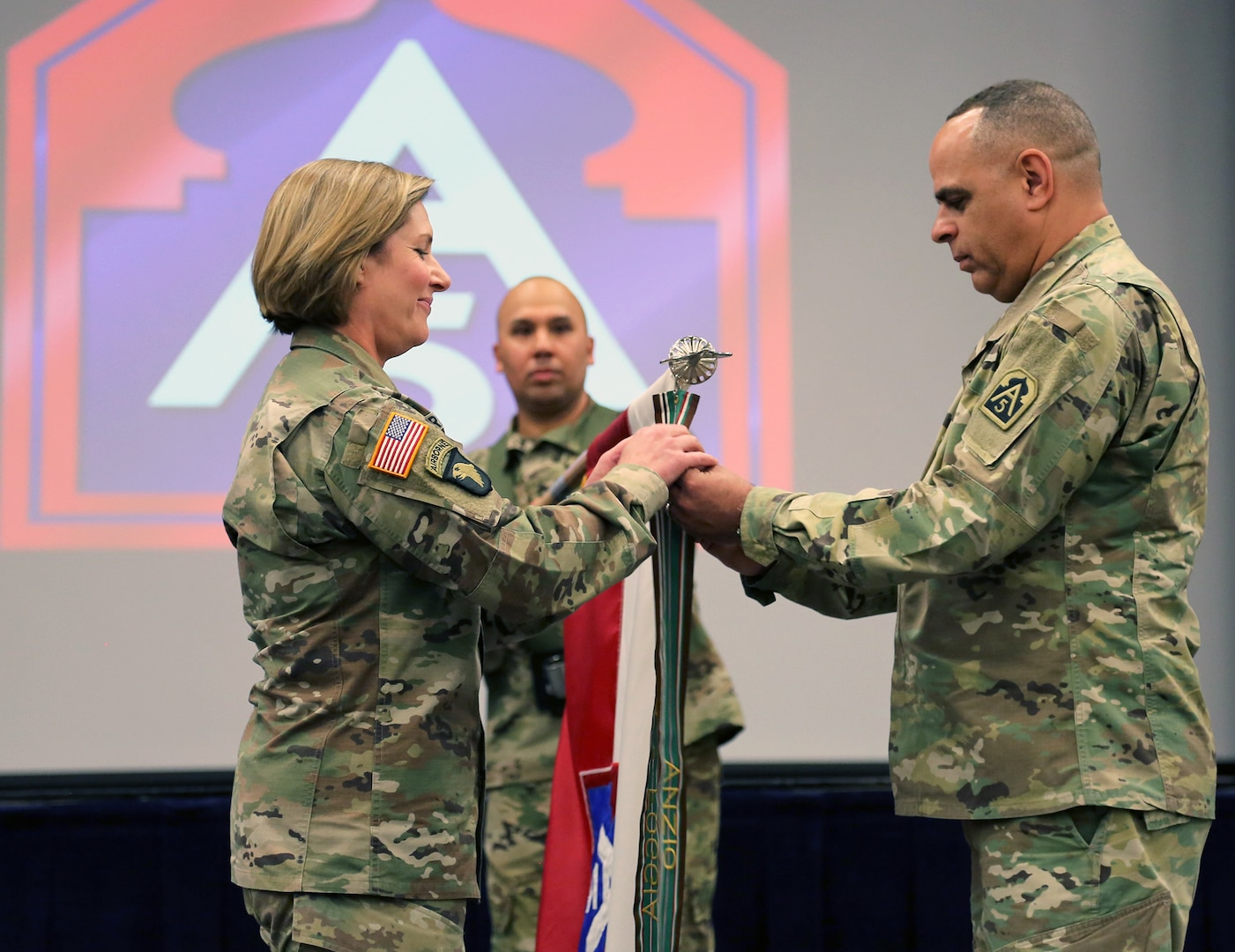 Lt. Gen. Laura Richardson, commanding general, U.S. Army North (Fifth Army) and senior commander, Joint Base San Antonio-Fort Sam Houston and JBSA-Camp Bullis, and Army North Command Sgt. Maj. Alberto Delgado, senior enlisted leader, JBSA-Fort Sam Houston and JBSA-Camp Bullis, place a streamer on the unit's colors during a unit birthday ceremony at the Military & Family Readiness Center at JBSA-Fort Sam Houston Jan. 10.