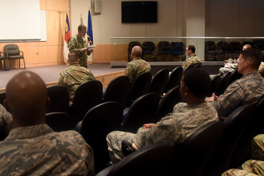 Members of the North Carolina Air National Guard listen as U.S. Air Force North Carolina Assistant Adjutant General for Air, Brig. Gen. Stephen Mallette delivers a speech before presenting Master Sgt. Daniel Judd and Master Sgt. Kernice Locklear, 263rd Combat Communications Squadron with awards during an all-call held at the New London, N.C. Air National Guard Base (NCANG) headquarters, Jan. 12, 2020. Members of the NCANG celebrated the accomplishments of Master Sgts. Judd and Locklear who attended the United States Marine Corps Staff Non-Commissioned Officer Academy last year in an effort to better understand the traditions and customs of a sister service. Since attending the academies, Judd and Locklear have implemented U.S. Marine Corps. practices such as sharing unit history and helping newer Airmen feel more involved with more responsibilities.