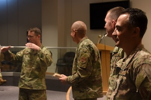 U.S. Air Force North Carolina Assistant Adjutant General for Air, Brig. Gen. Stephen Mallette (far left), and State Command Chief Master Sgt. David Rodriguez (left), commend Master Sgt. Daniel Judd (right) and Master Sgt. Kernice Locklear (far right), 263rd Combat Communications Squadron with awards during an all-call held at the New London, N.C. Air National Guard Base (NCANG) headquarters, Jan. 12, 2020. Members of the NCANG celebrated the accomplishments of Master Sgts. Judd and Locklear who attended the United States Marine Corps Staff Non-Commissioned Officer Academy last year in an effort to better understand the traditions and customs of a sister service. Since attending the academies, Judd and Locklear have implemented U.S. Marine Corps. practices such as sharing unit history and helping newer Airmen feel more involved with more responsibilities.