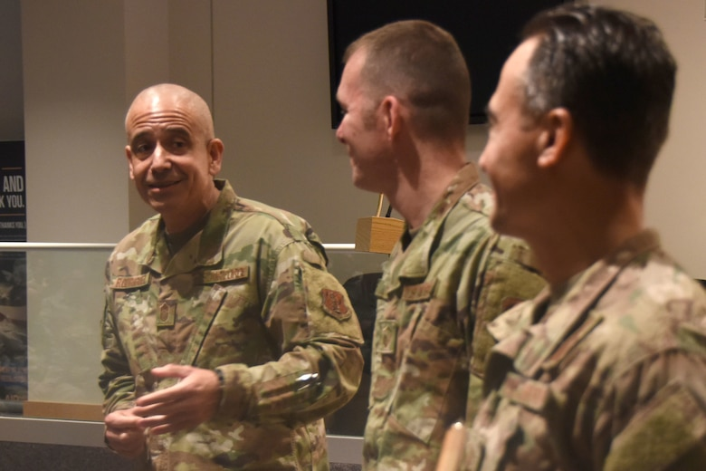 U.S. Air Force North Carolina State Command Chief Master Sgt. David Rodriguez (left) commends Master Sgt. Daniel Judd (center) and Master Sgt. Kernice Locklear (right), 263rd Combat Communications Squadron after being presented with awards during an all-call held at the New London, N.C. Air National Guard Base (NCANG) headquarters, Jan. 12, 2020. Members of the NCANG celebrated the accomplishments of Master Sgts. Judd and Locklear who attended the United States Marine Corps Staff Non-Commissioned Officer Academy last year in an effort to better understand the traditions and customs of a sister service. Since attending the academies, Judd and Locklear have implemented U.S. Marine Corps. practices such as sharing unit history and helping newer Airmen feel more involved with more responsibilities.