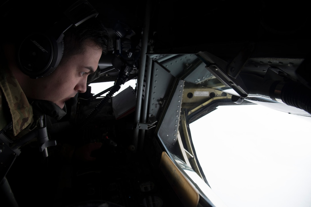 Senior Airman Chuck Howard, in-flight refueling craftsman, 141st Air Refueling Squadron, refuels a KC-46A Pegasus for the first time over New Jersey, Jan. 6, 2020. The KC-46A is the first phase in recapitalizing the U.S. Air Force's aging tanker fleet. (U.S. Air National Guard photo by Airman 1st Class Andrea A. S. Williamson)