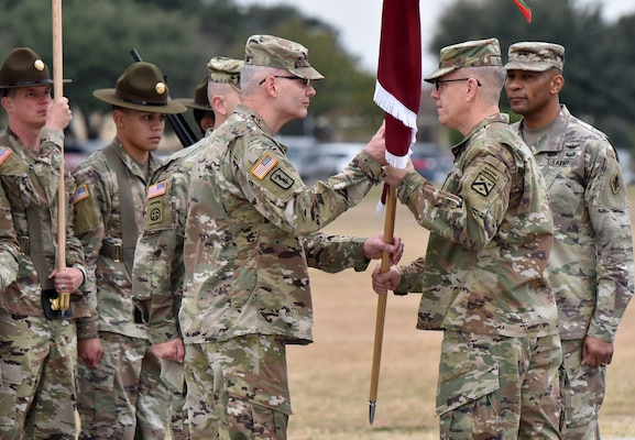 Lt. Gen. James E. Rainey (center), commanding general, U.S. Army Combined Arms Center, passes the MEDCoE colors to incoming commander Maj. Gen. Dennis P. LeMaster (left) as outgoing commander Maj. Gen. Patrick D. Sargent looks on during the U.S. Army Medical Center of Excellence change of command ceremony at Joint Base San Antonio-Fort Sam Houston Jan. 10.