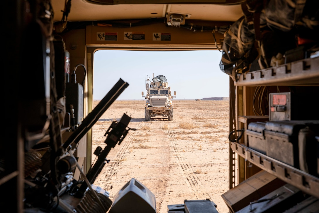 U.S. Soldiers of the 663rd Ordnance Company, 242nd Ordnance Battalion, drive military vehicles to the explosives range at Al Asad Air Base, Iraq, Nov. 29, 2019. The Explosive Ordnance Disposal Soldiers utilize these ranges to provide controlled disposal of explosive Ordnance. The Coalition is in Iraq by invitation of, and operates in close coordination with, the Government of Iraq. (U.S. Army photo by Spc. Derek Mustard)
