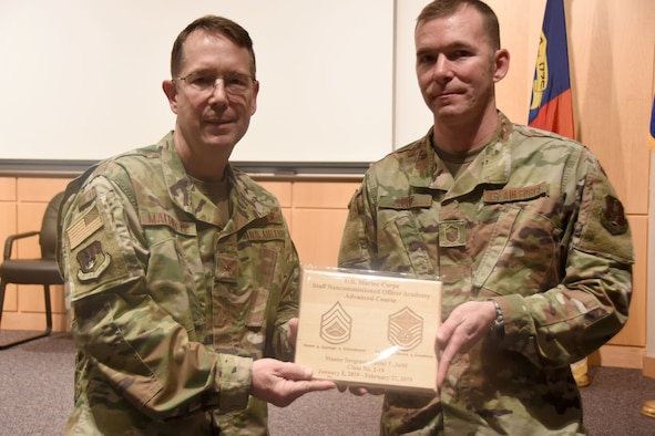 U.S. Air Force Brig. Gen. Stephen Mallette (left), the North Carolina assistant adjutant general for air, presents Master Sgt. Daniel Judd (right), 263rd Combat Communications Squadron,  with an award during an all-call held at the North Carolina Air National Guard headquarters, Jan. 12, 2020. Judd attended the United States Marine Corps Staff Non-Commissioned Officer Academy last year in an effort to better understand the traditions and customs of a sister service. (U.S. Air National Guard photo by Staff Sgt. Laura Montgomery)