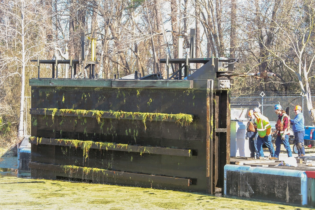 Work crews remove one of two canal gates for refurbishment at South Mills Lock in North Carolina, Jan. 7, 2020.