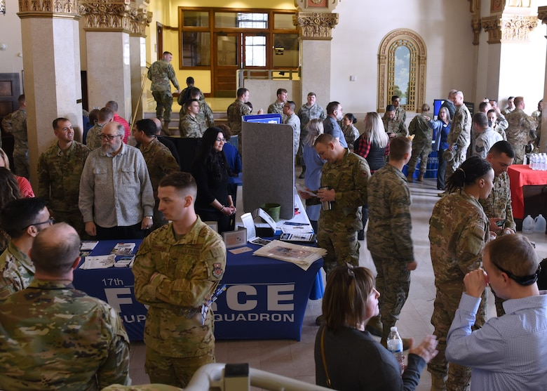 Goodfellow members socialize and view information about the base before the Commander's Call at Murphey Performance Hall in San Angelo, Texas, Jan. 9, 2020.  Light refreshments and a variety of information booths were available before and after the event. (U.S. Air Force photo by Airman 1st Class Abbey Rieves)