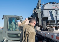 Staff Sgt. Dustin Phillips, 311th Aircraft Maintenance Unit support non-commissioned officer in charge, drives a forklift while Staff Sgt. Andrew Marsh, 311th AMU lead support technician, gives directions on loading a ground power unit onto the semi-truck, Jan. 6, 2020, on Holloman Air Force Base, N.M. Airmen from the maintenance group loaded cargo that was integral to the 311th Fighter Squadron's mission in Key West, Fla. (U.S. Air Force photo by Airman 1st Class Autumn Vogt)
