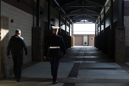 Michael Capps, Oak Hills High School Principal, walks alongside Sgt. Mark Reinsberg, a Marine recruiter with Recruiting Station Riverside during the Principal for a Day event held at Oak Hills High School in Oak Hills, CA, Nov. 21, 2019. Principal for a Day is a program run by Hesperia Unified School District designed to show local leaders and community members the state of the schools in the area and discuss what can be improved. (U.S. Marine Corps photo by Sgt. Juan Madrigal)