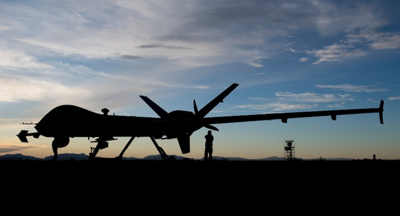 Airmen from the 29th Aircraft Maintenance Unit check over the first MQ-9 Reaper to be transported through ferry flight here, Jan. 8, 2020, on Holloman Air Force Base, N.M. Transporting remotely piloted aircraft from California meant using the National Airspace System and required extra documentation to permit the flight. (U.S. Air Force photo by Airman 1st Class Autumn Vogt)