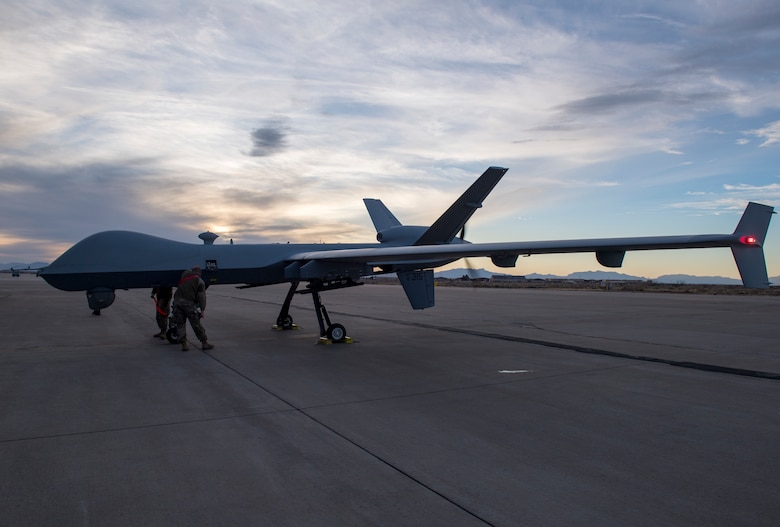 Airmen from the 29th Aircraft Maintenance Unit look over the 49th Wing's newest MQ-9 Reaper, Jan. 8, 2020, on Holloman Air Force Base, N.M. This is the first remotely piloted aircraft to be ferried through the National Airspace to Holloman. (U.S. Air Force photo by Airman 1st Class Autumn Vogt)