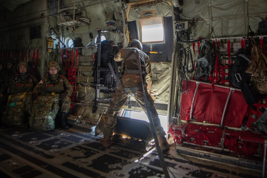 Loadmaster closes side door to C-130J Super Hercules.