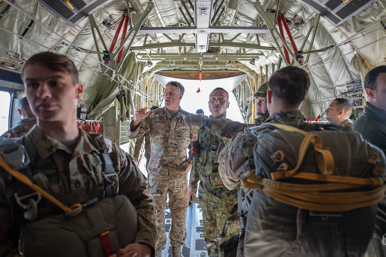 Soldiers and Airmen prepare for New Year Jump aboard U.S. Air Force C-130J Super Hercules.