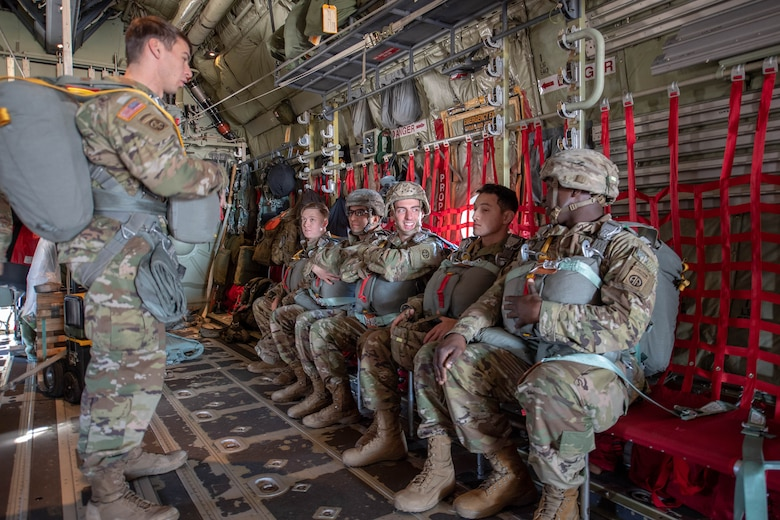 Soldiers prepare for New Year Jump aboard U.S. Air Force C-130J Super Hercules.