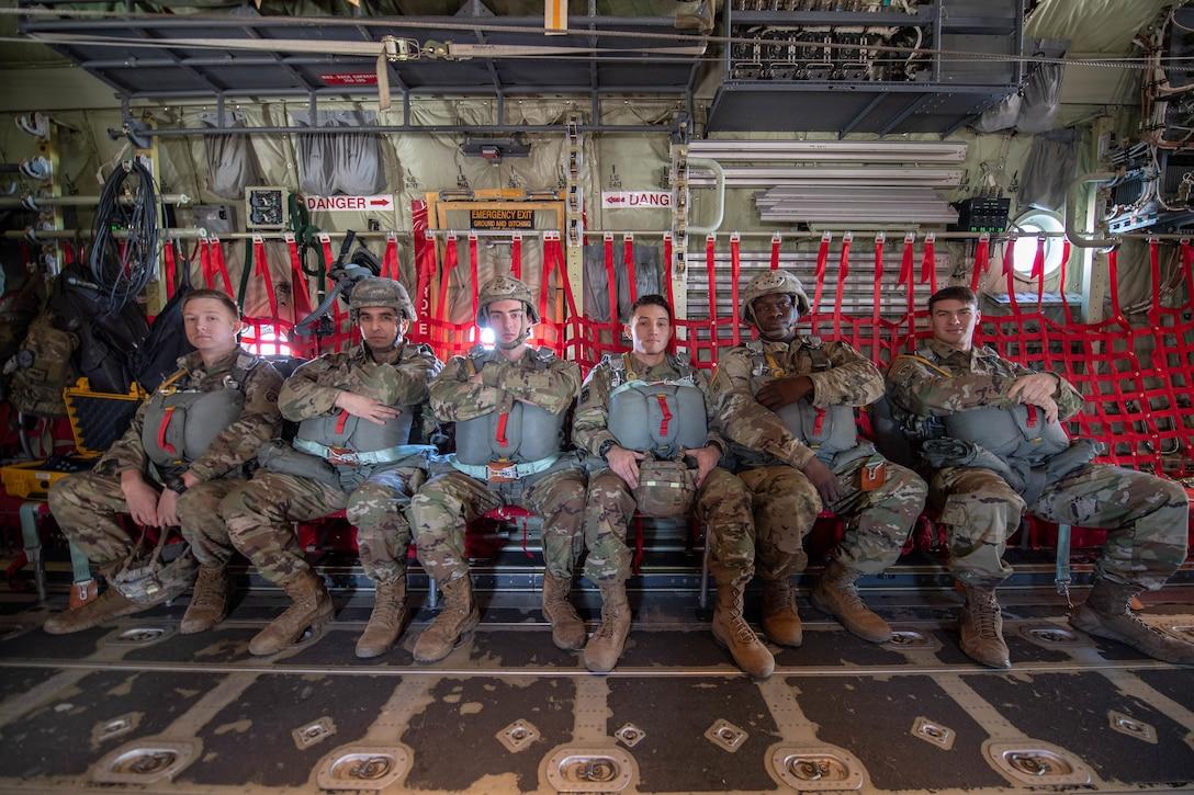 U.S. Army Reserve Alaska & 82nd Airborne soldiers sit inside C-130J Super Hercules.