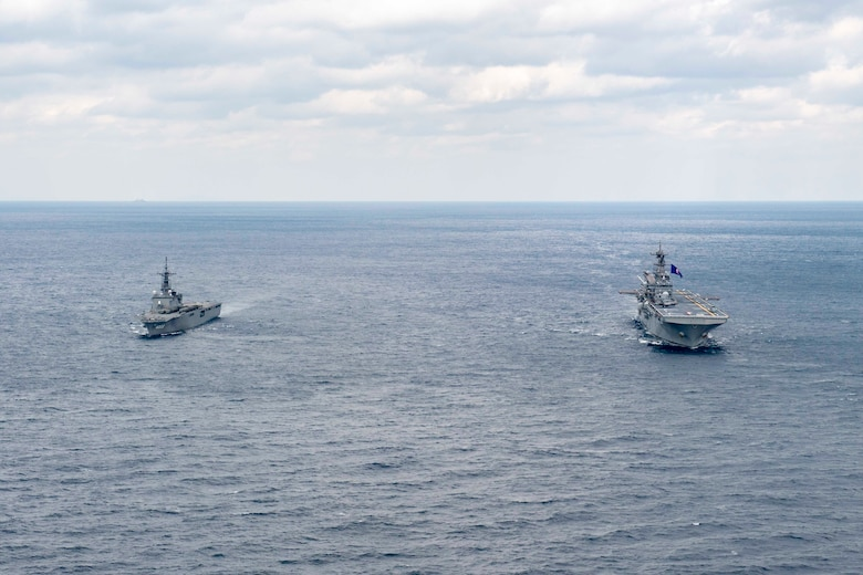 Amphibious assault ship USS America (LHA 6) and Japan Maritime Self-Defense Force amphibious transport dock ship JS Kunisaki (LST 4003) operate together in the East China Sea.