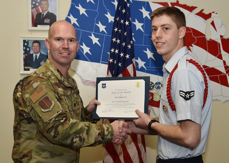 U.S. Air Force Lt. Col. Kevin Boss, 17th Training Group deputy commander, presents the 17th Training Group Rope of the Month award to Airman 1st Class Tyler Wright, 315th Training Squadron student, at Brandenburg Hall on Goodfellow Air Force Base, Texas, Jan. 10, 2019. The 315th TRS's vision is to develop combat-ready intelligence, surveillance and reconnaissance professionals and promote an innovative squadron culture and identity unmatched across the U.S. Air Force. (U.S. Air Force photo by Staff Sgt. Chad Warren)