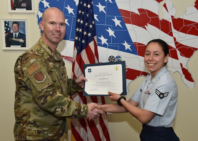 U.S. Air Force Lt. Col. Kevin Boss, 17th Training Group deputy commander, presents the 315th Training Squadron Student of the Month award to Airman 1st Class Allissa Castro, 315th TRS student, at Brandenburg Hall on Goodfellow Air Force Base, Texas, Jan. 10, 2020. The 315th TRS's mission is to train, educate, and mentor future intelligence, surveillance, and reconnaissance warriors through innovation. (U.S. Air Force photo by Staff Sgt. Chad Warren)