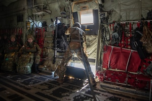 Loadmaster closes side door to C-130J Super Hercules.
