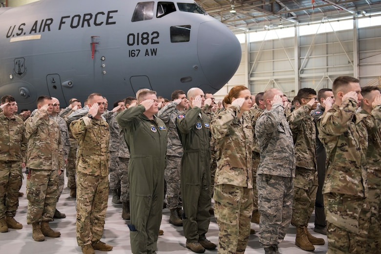 167th Airlift Wing Airmen salute their new commander during a change of command ceremony held in an aircraft hangar, Jan. 12, 2020. Col. Martin Timko assumed command of the wing, Col. David Cochran relinquished command during the ceremony.