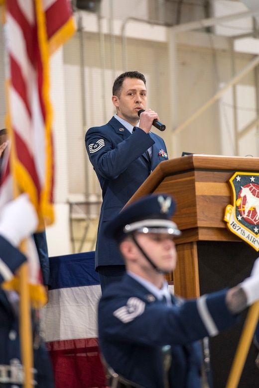 Tech. Sgt. Joshua Robins sings the national anthem flag at the start of a change of command ceremony, Jan. 12, 2020. Col. Martin Timko assumed command of the wing and Col. David Cochran relinquished command during the ceremony.