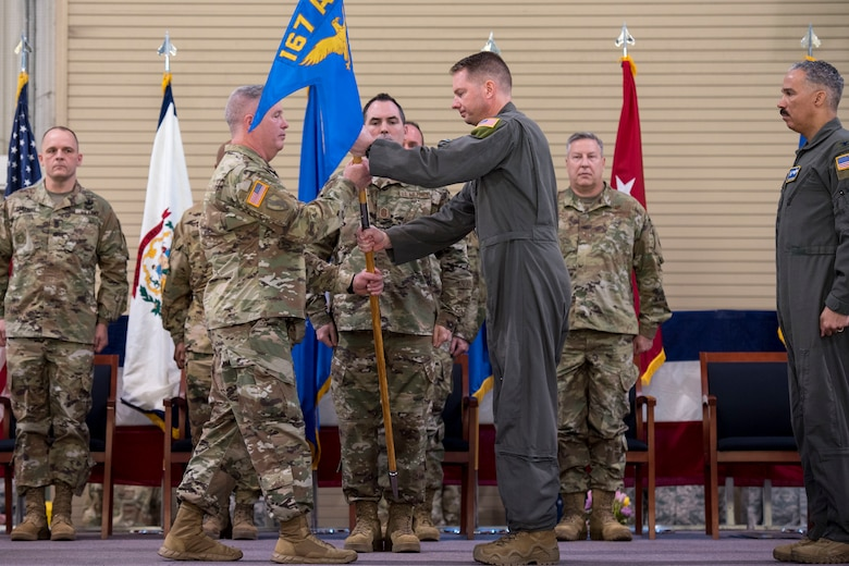 West Virginia National Guard Adjutant General, Maj. Gen. James Hoyer and Col. Martin Timko ceremoniously exchange the 167th Airlift Wing guidon during a change of command ceremony, Jan. 12, 2020. Timko assumed command of the wing, Col. David Cochran relinquished command during the ceremony.