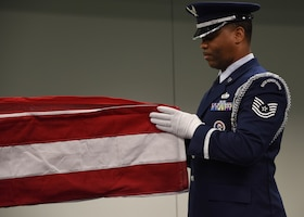 Tech. Sgt. Diontae Walker, a ceremonial guardsman assigned to the 911th Mission Support Group, folds the American flag during a base honor guard military funeral demonstration at the Pittsburgh International Airport Air Reserve Station, Pennsylvania, Dec. 8, 2019.