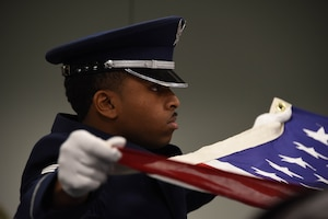 Senior Airman Joseph Dukes III, a ceremonial guardsman assigned to the 911th Airlift Wing, folds the American flag during a base honor guard military funeral demonstration at the Pittsburgh International Airport Air Reserve Station, Pennsylvania, Dec. 8, 2019.